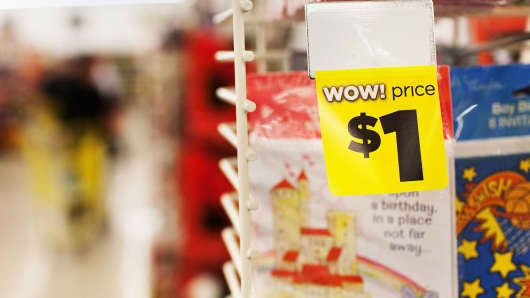 A one-dollar price tag appears on a greeting card at a Dollar General store.