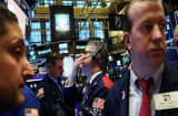 Global stocks mixed after Brussels attacks