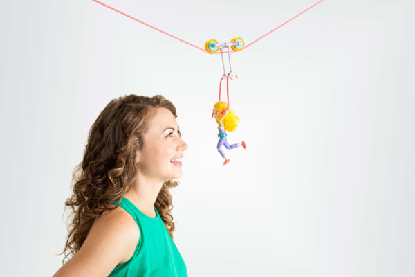 "Debbie Sterling, the founder of GoldieBlox, and ""Goldie"" on a zipline made with GoldieBlox."