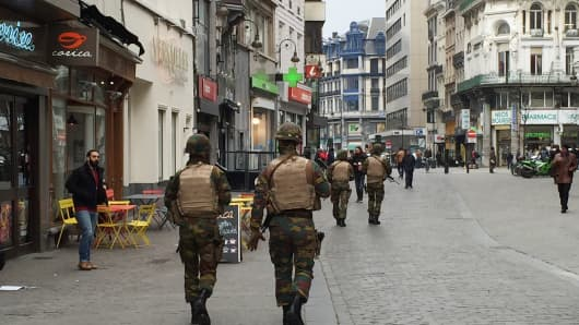 Belgian military forces patrol tourist streets in Brussels.