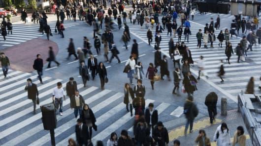 Pedestrians at a crossing in Shibuya, Japan.