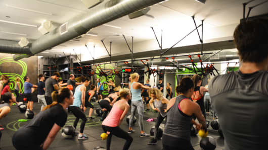 The before-work crowd does High Intensity Training at the Fhitting Room on Manhattan's West 19th St.