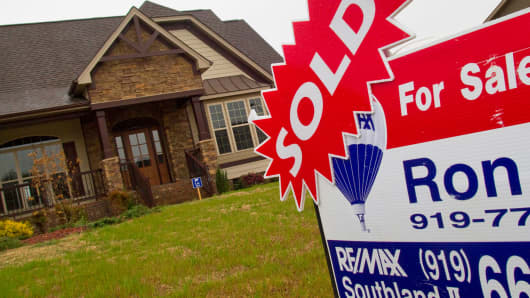 A sold sticker is displayed on a for sale sign outside a home in Garner, North Carolina.