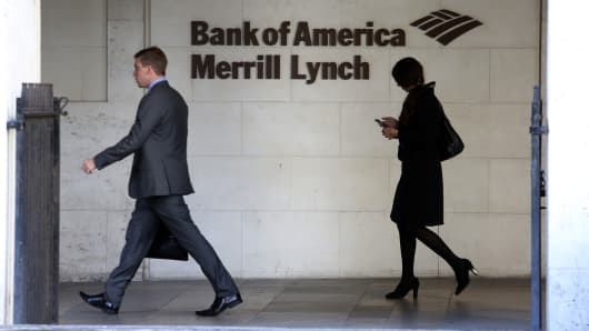 Visitors pass a sign as they exit the Bank of America Merrill Lynch Financial Centre in London, U.K.