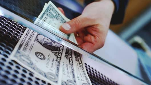 Bank teller handling money