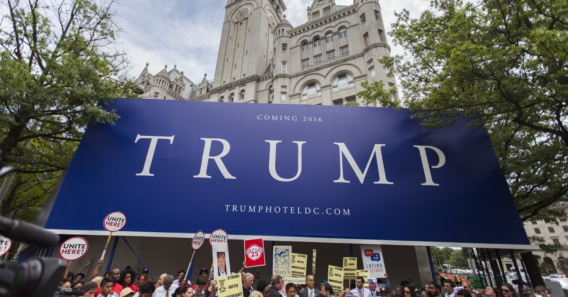 To move into the White House, Trump may have to dump DC hotel