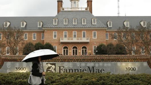 Woman walks past Fannie Mae in Washington.