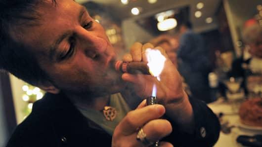 Smoking indoors, lighting cigar