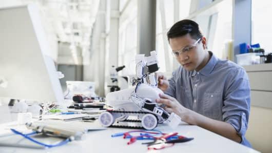 Engineer assembling robotic parts
