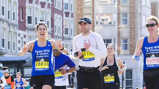 Simon Wheatcroft (middle) runs the Boston Marathon in 2016