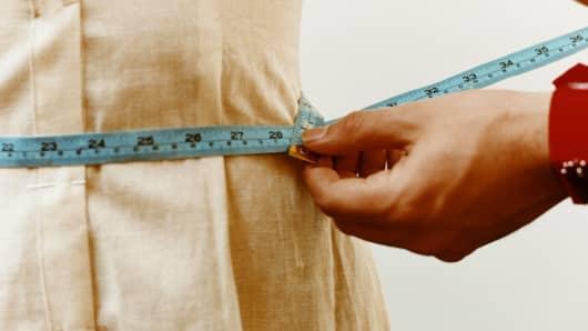 Diet, tape measure, waistline