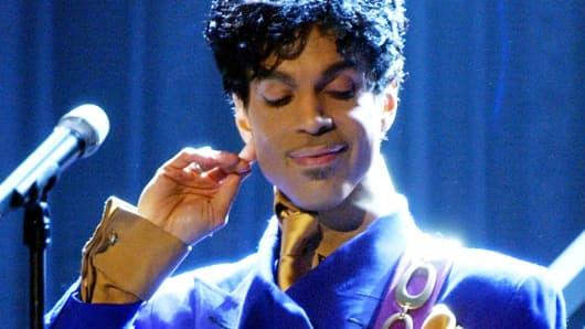 Prince performs 'Purple Rain' in Los Angeles, Feb. 8, 2004.