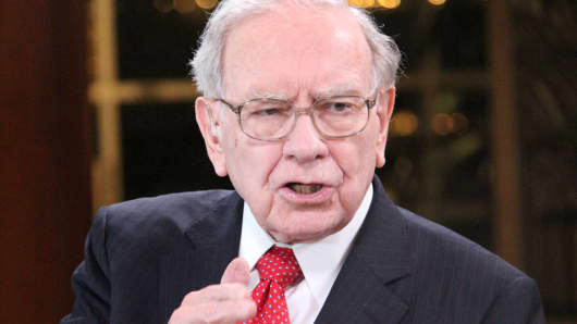 Warren Buffett takes $1 bn stake in Apple