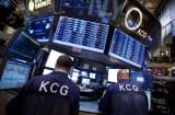 Traders from KCG Holdings Inc. work on the floor of the New York Stock Exchange.