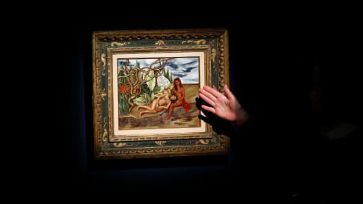 An Art specialist at Christie's speaks about Frida Kahlo's 'Dos desnudos en el bosque (La Tierra Misma)' on April 29, 2016, in New York.