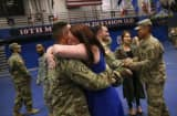 Tiffany Hart embraces her husband SPC Lucas Hart after he and fellow U.S. Army soldiers returned from Iraq on May 17, 2016 at Fort Drum, New York.