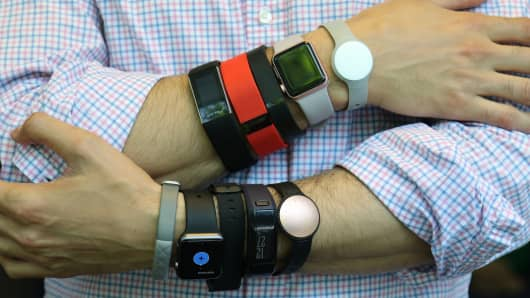 A variety of wearable fitness devices on display.