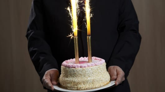Businessman with cake in hands