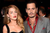 Actors Amber Heard (L) and Johnny Depp attend the 'Black Mass' premiere during the 2015 Toronto International Film Festival at The Elgin on September 14, 2015 in Toronto, Canada.