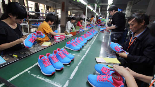 Chinese workers making shoes at a factory in Jinjiang, in southeast China's Fujian province.