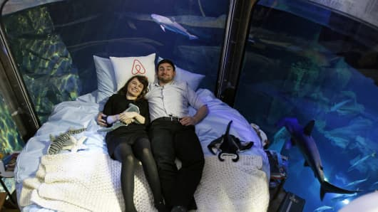 Hannah Simpson and Alister Shipman, from Northern Ireland, slept surrounded by a shark tank after winning a night's stay at the Aquarium de Paris in April through an Airbnb competition.