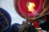 Fire raising hot air balloons, soaring, raising