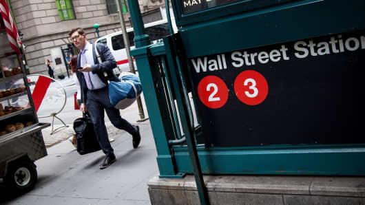 A pedestrian walks past the Wall Street subway station near New York Stock Exchange.