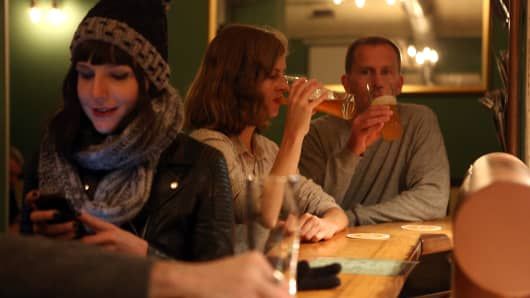 Young adults drinking at a bar