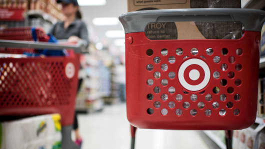 Customers use Target shopping carts at a store in Chicago, Illinois.