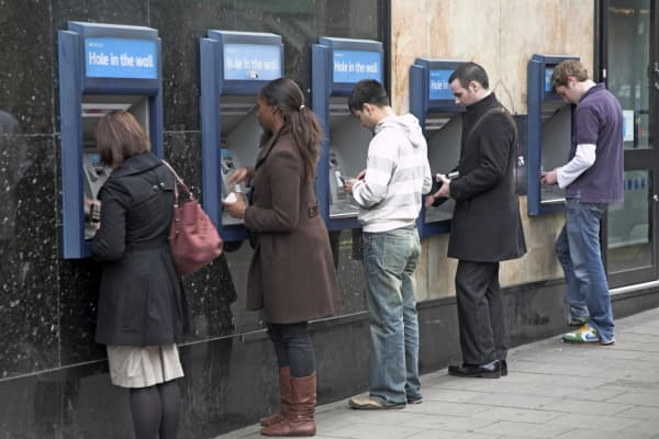 Bankers at an ATM