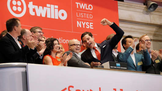 Jeff Lawson, (C) Founder, CEO, & Chairman of Communications software provider Twilio Inc., rings the opening bell to celebrate his company's IPO at the New York Stock Exchange in New York City, June 23, 2016.