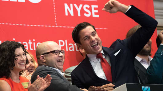 Twilio Inc. founder and CEO Jeff Lawson (C, in glasses) reacts after ringing the opening bell to celebrate Twilio's initial public offering, at the New York Stock Exchange, June 23, 2016 in New York City.