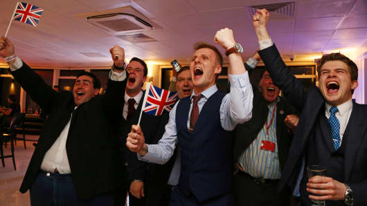Leave.EU supporters wave Union flags and cheer as the results come in at the Leave.EU referendum party at Millbank Tower in central London early in the morning of June 24, 2016.