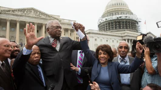 John Lewis (D-GA), (3rd L), James Clyburn (D-SC), Maxine Waters (D-CA) and Charles Rangel, (D-NY), right, speak with supporters outside the U.S. Capitol building June 23, 2016 in Washington, DC.