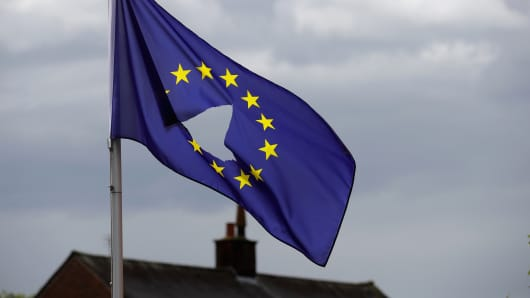 A European Union flag, with a hole cut in the middle, flies at half-mast outside a home in Knutsford Cheshire after today's historic referendum on June 24, 2016 in Knutsford, United Kingdom.