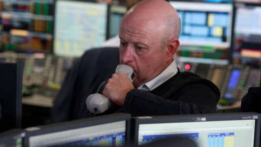 A traders from BGC Partners, a global brokerage company in London's Canary Wharf financial centre waits for European stock markets to open early June 24, 2016 after Britain voted to leave the European Union in the EU BREXIT referendum.