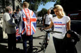 A vote remain supporter walks past a vote leave supporter outside Downing Street after Britain voted to leave the European Union.