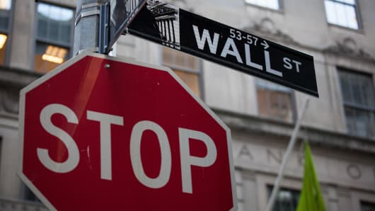 A Wall Street street sign is displayed near the New York Stock Exchange (NYSE) in New York, U.S.
