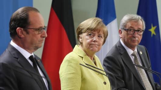 German Chancellor Angela Merkel, French President Francois Hollande (L) and European Union Commission President Jean-Claude Juncker.