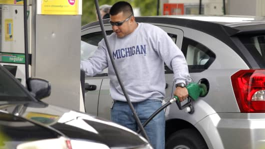 A customer puts gas in his car at a BP gas station in Romulus, Michigan.