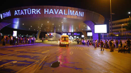 Ambulance cars arrive at Turkey's largest airport, Istanbul Ataturk, after a reported explosion.