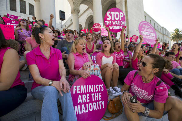 Activists chant as they rally in support of Planned Parenthood