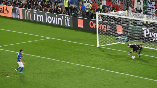 German goalkeeper Manuel Neuer saved a penalty kick from Italy's defender Matteo Darmian during the Euro 2016 quarter-final football match between Germany and Italy at the Matmut Atlantique stadium in Bordeaux on July 2, 2016.