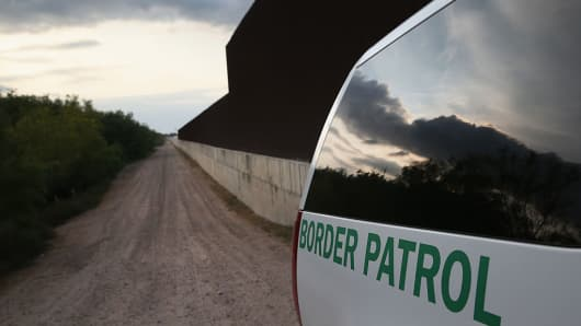 The border fence along the lower Rio Grande Valley between McAllen and Harlingen, Texas. The Weslaco Border Patrol Station is responsible for 40 miles of river boundary.