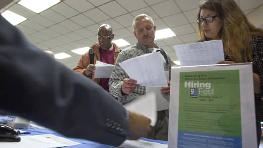 People seek employment at a job fair for the homeless in Los Angeles.