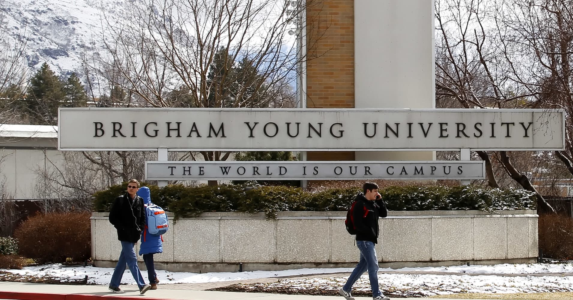 Students walks past the entrance of Brigham Young University in Provo, Utah.