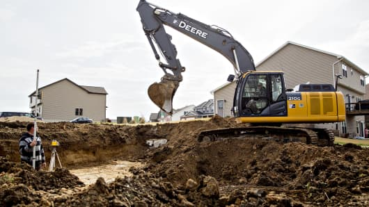 A Deere & Co. 210G excavator is used to dig the foundation for a new home in Dunlap, Illinois