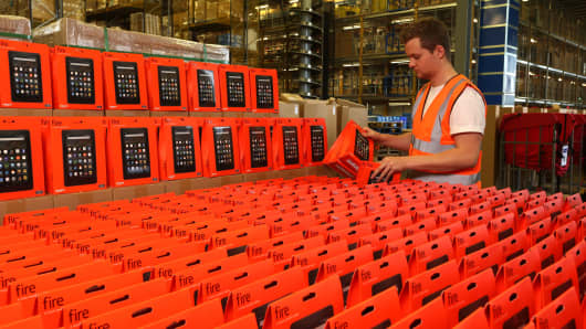 Fire tablets and Fire TV Sticks being prepared at Amazon's Fulfilment Centre in Milton Keynes ahead of Amazon's annual Prime Day shopping event.