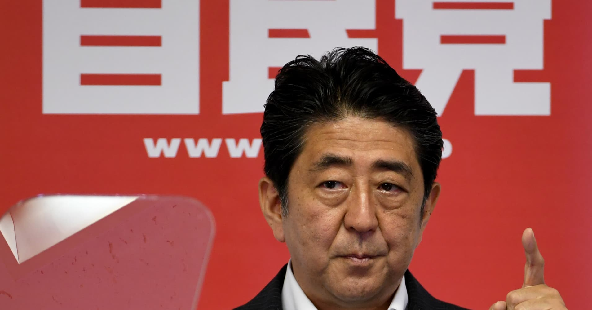 Japan's Abe orders new stimulus after election win, as machinery orders 'stall'