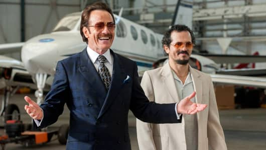 Bryan Cranston stars as undercover U.S. Customs agent Robert Mazur and John Leguizamo as his partner Emir Abreu in THE INFILTRATOR